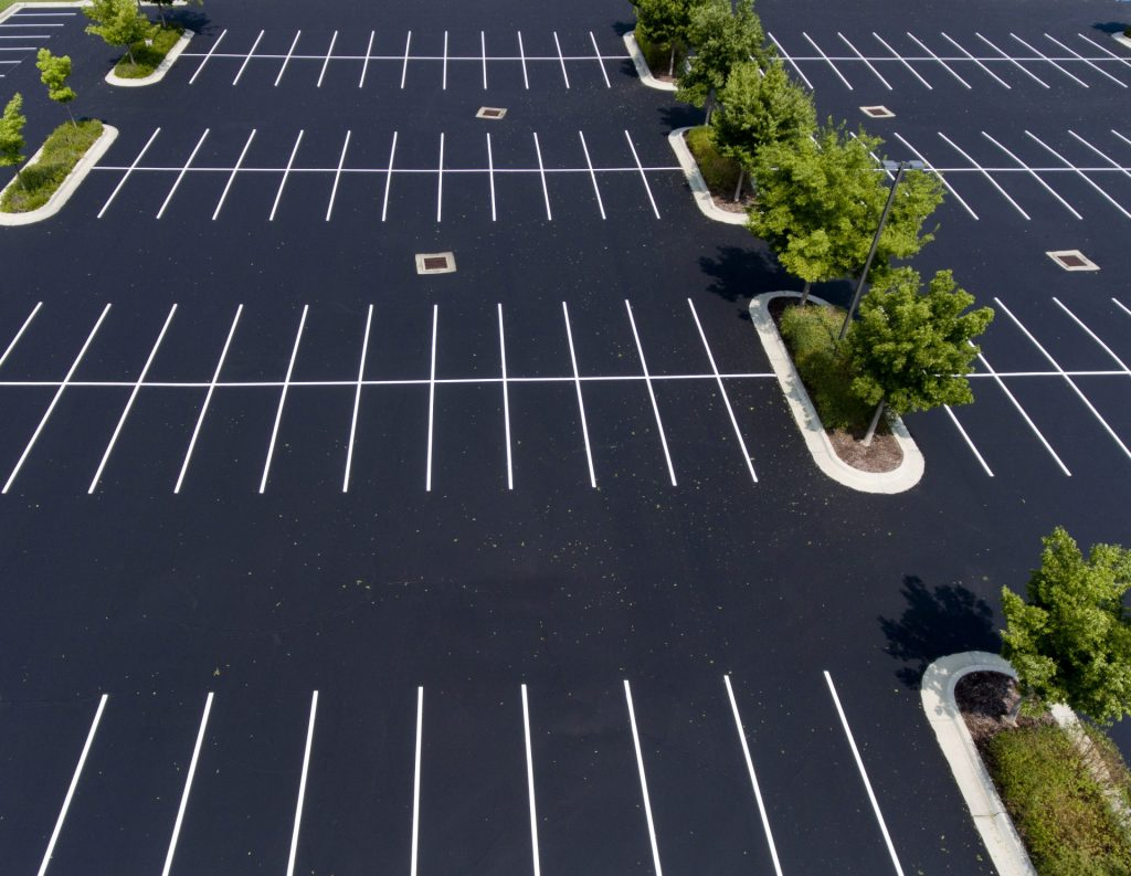 4 Areas in Your Parking Lot That Need Pressure Washing the Most